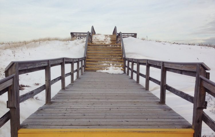 walkway to snow filled beach