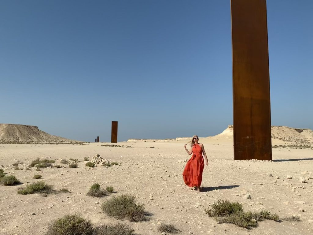 Tijana in Qatar Doha in the midst of East-West/West-East Sculptures by Richard Serra  in Qatari Desert. Kalita dress.