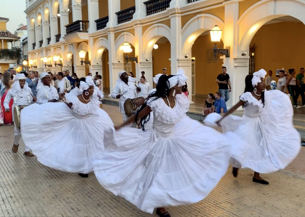 Wedding procession in Colombia with dancers in white dresses