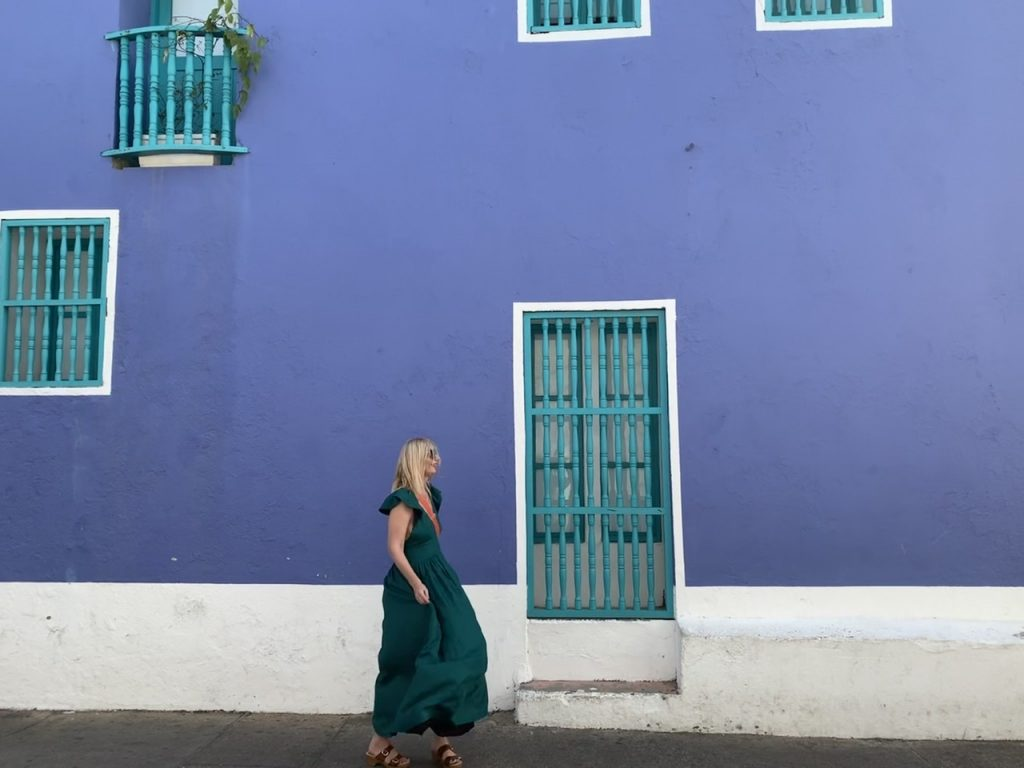 Bright purple walls with blue window fixtures in Colombia  Kalita dress