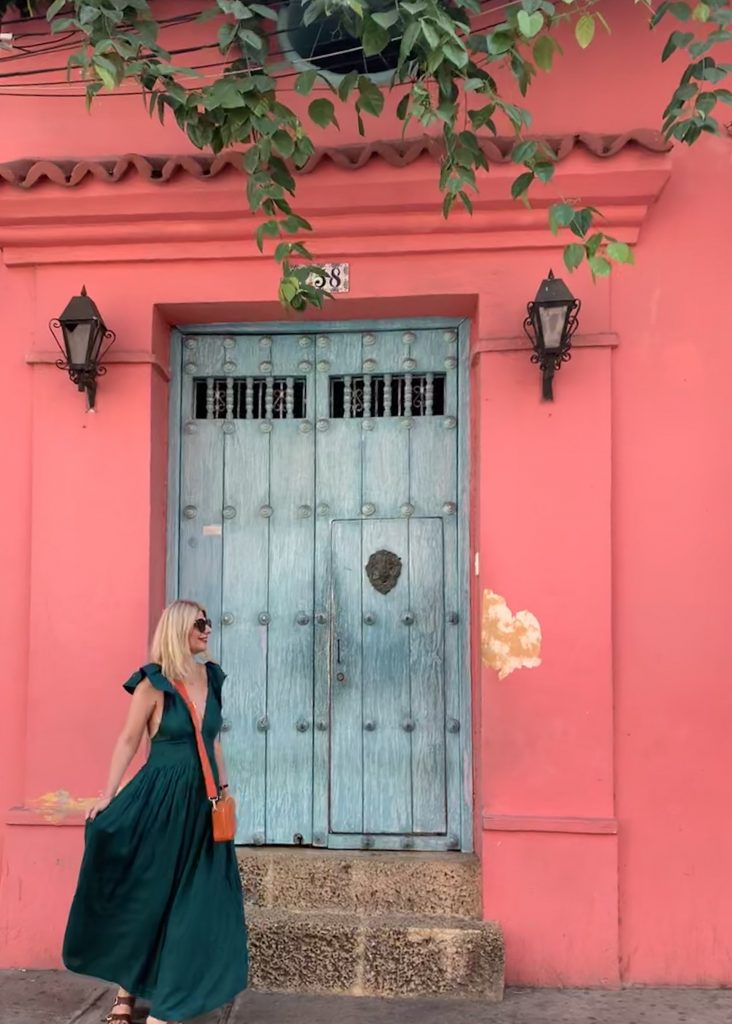 Stunning pink walls with light blue doors in Cartagena and Tijana Dress Kalita