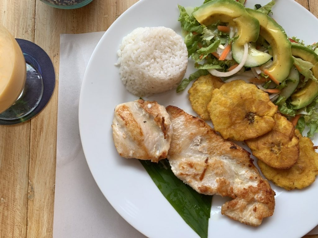 Traditional Colombian chicken rice dish and lulo juice