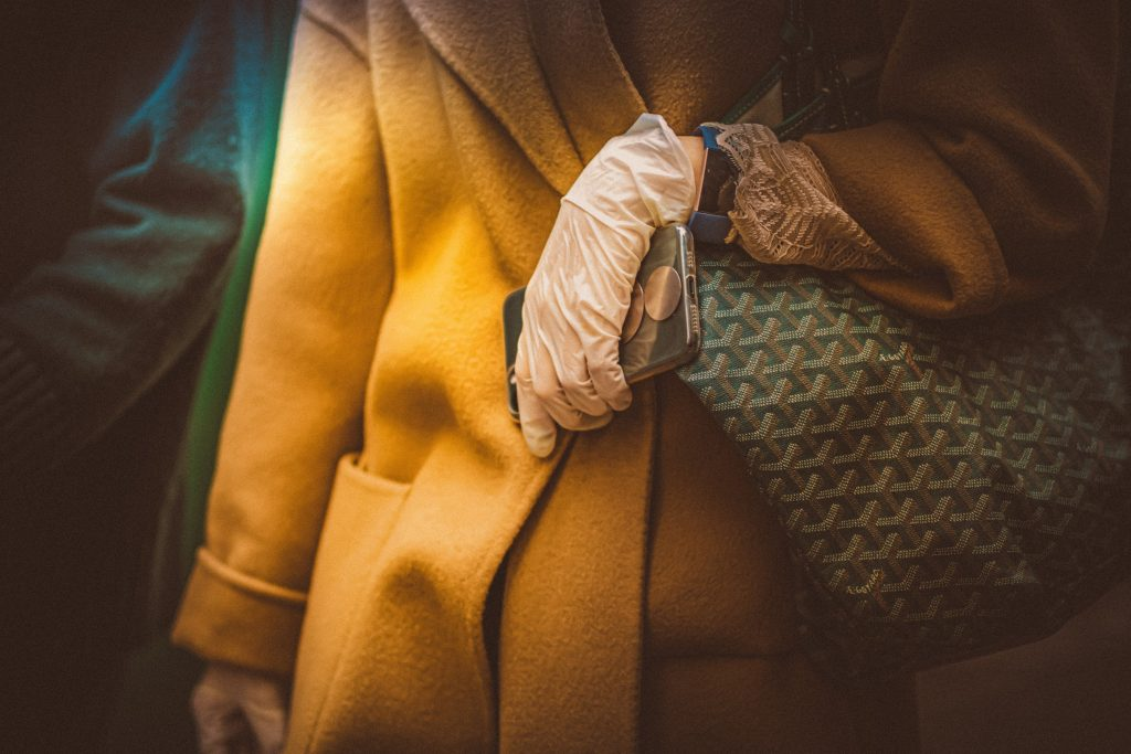A hand wearing a glove during the pandemic - Photo by Petar Pavlov.