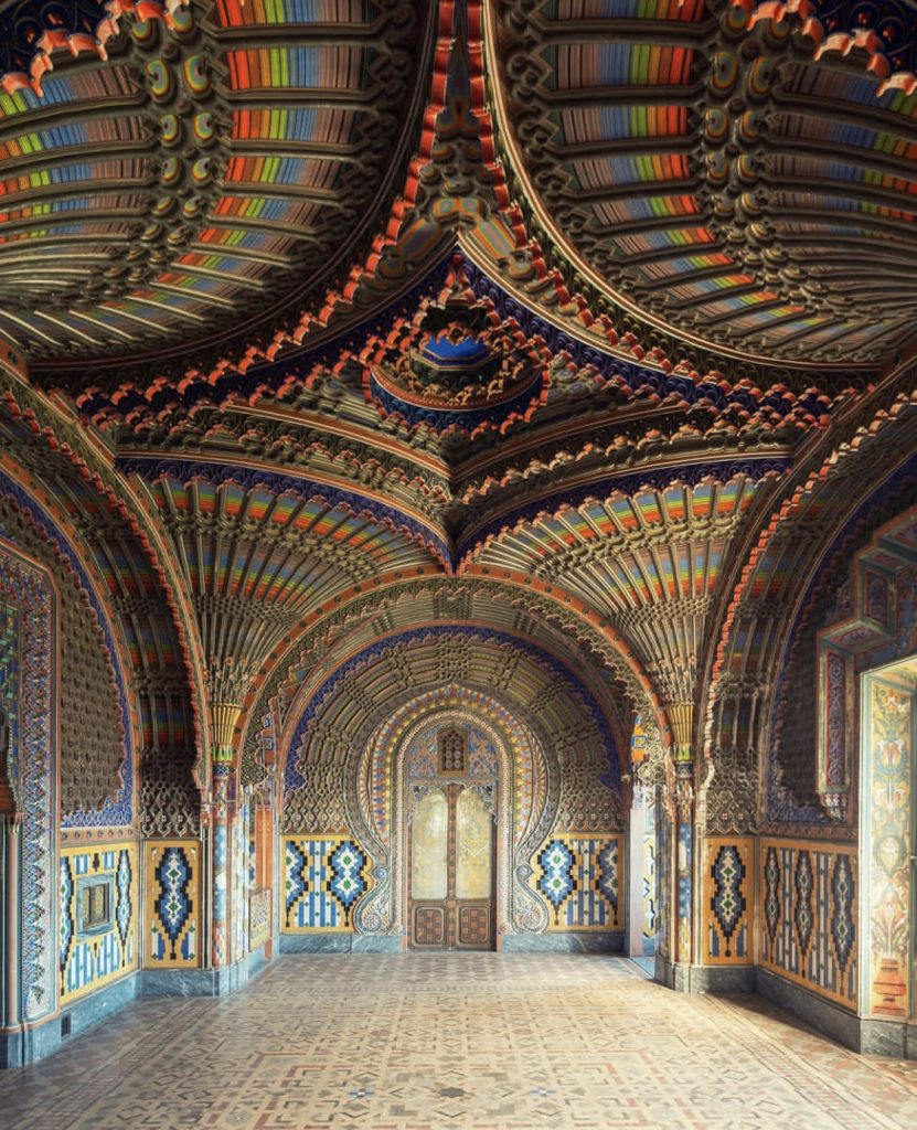 La Sala dei Pavoni by N. Bertellotti. An exquisite abandoned room with rainbow colored walls filled with ornate accents and details.
