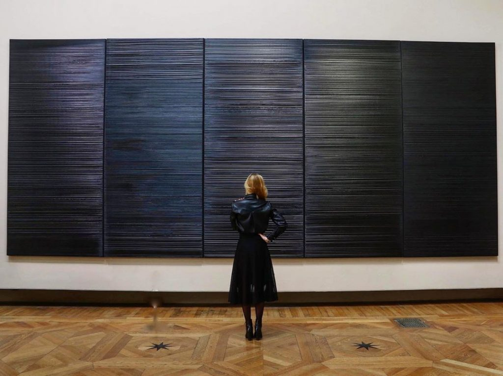 Woman admiring Pierre Soulages work