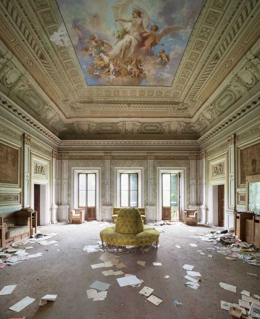Il Demone della Frivolezza by Nicola Bertellotti. An abandoned sitting area with a gorgeous detailed ceiling of angels.