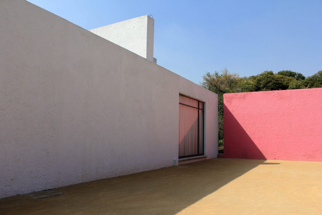 Shadow and light play against soft pink and white walls. Barragan.