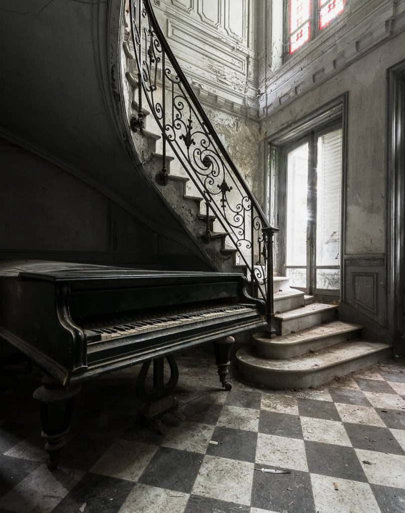 The long goodbye by Bertellotti. A piano left behind to decay.