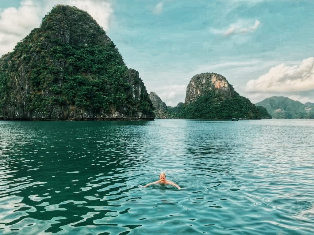Swimming in the jade colored waters of Halong Bay.