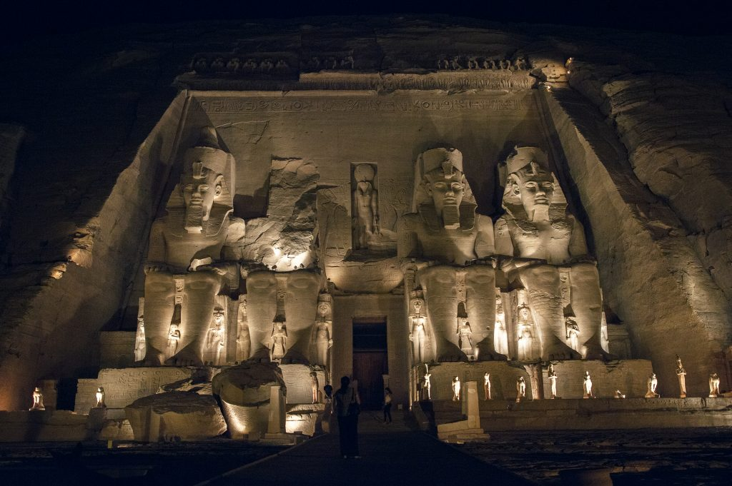 Abu Simbel Egypt at night with lights dancing against the structure.