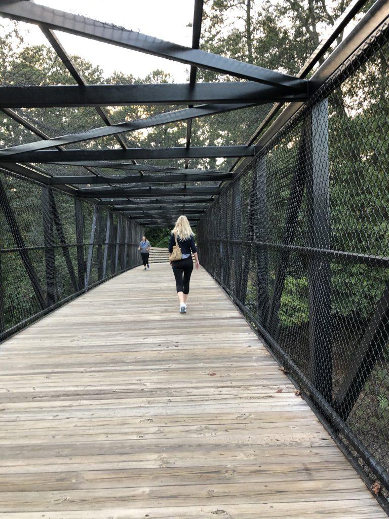 Walking on the bridge, over railroad tracks