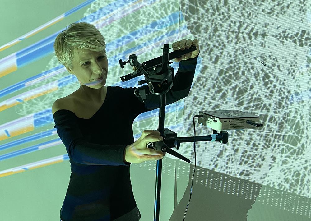 The artist adjusting her installation piece