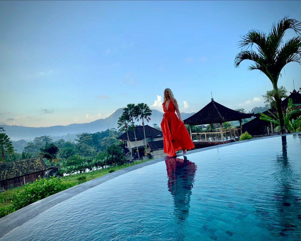 Tijana walking in a red dress in Bali