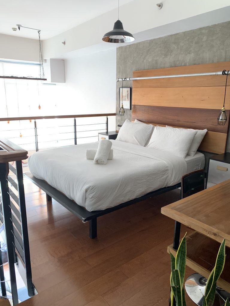 Top floor bedroom in loft Makati