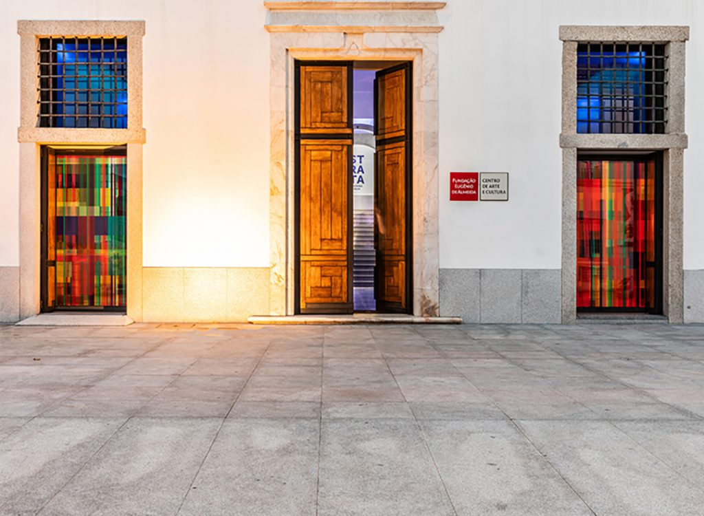 A door open between two artworks from the STRATA exhibition by Deanna Sirlin at the Fundação Eugénio de Almeida Portugal