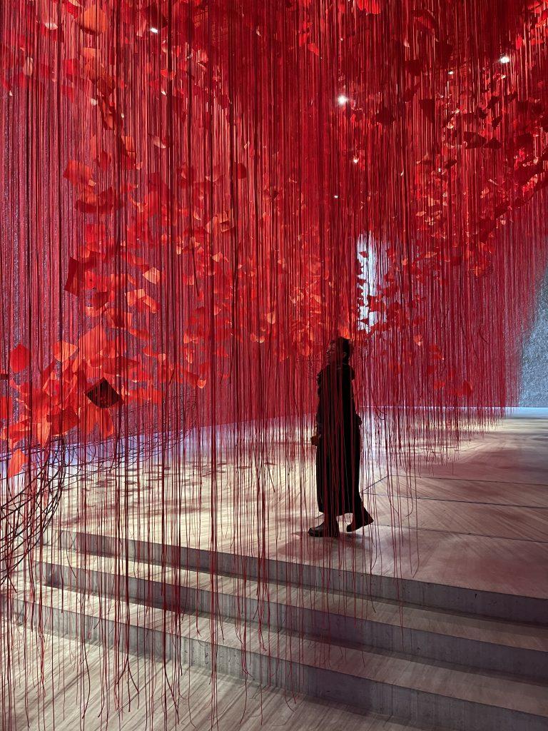 "Joanna walking through the ""I Hope"" Chiharu Shiota Exhibition in Berlin."