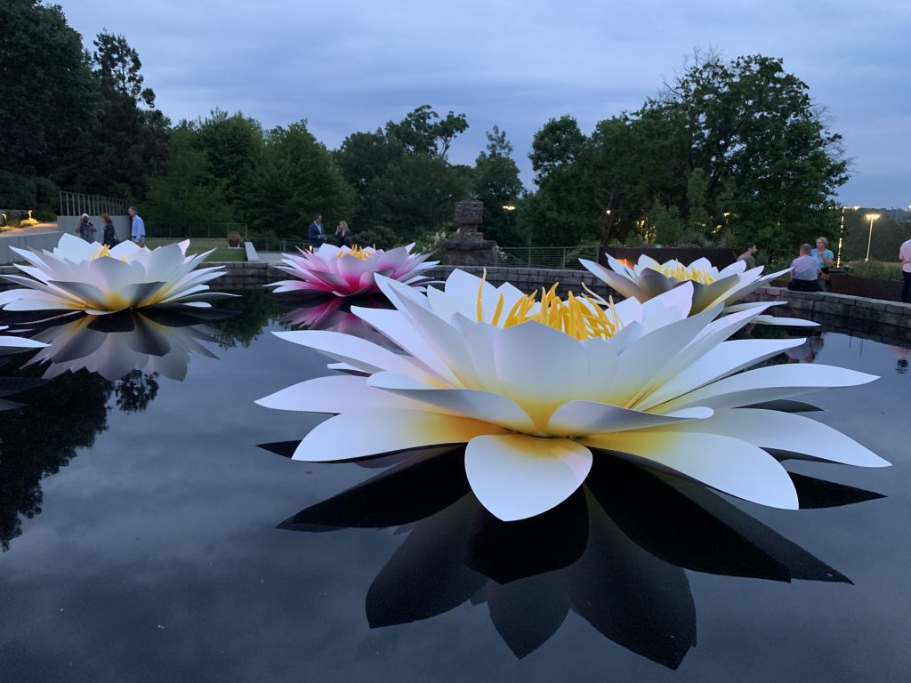 Massive water lily sculptures rest on the water at Atlanta Botanical Garden