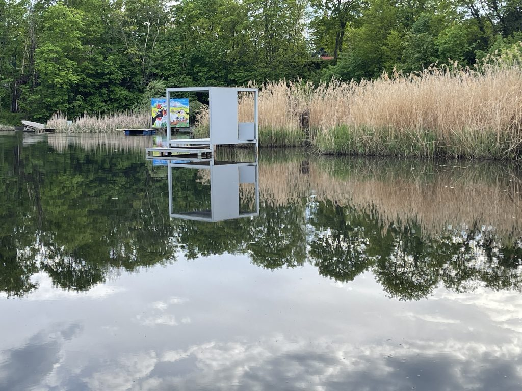 The sky reflects off the water at the Floating University of Berlin